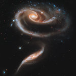 """The """"Rose,"""" an interacting pair of galaxies Arp 273. Credit: NASA, ESA, and the Hubble Heritage Team (STScI/AURA)."""